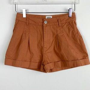 UO BDG high rise high waist rust pleat front short